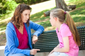 mom talking with daughter in park