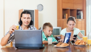 couple with   teenager with device during breakfast